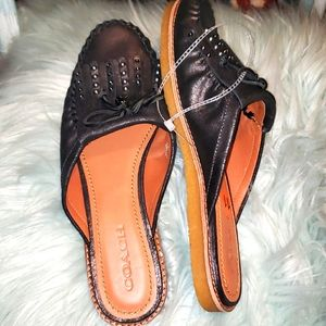 COACH leather slide loafers.